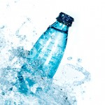 graphicstock-bottle-of-water-splash-on-a-white-background_HdXQXnu42l_SB_PM
